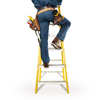Construction worker climbing yellow ladder.